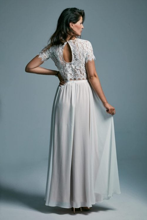 A delicate wedding dress with a light smooth skirt and a lace top Porto 23