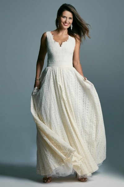 A wedding dress with wide straps and a classic cut with a slit Barcelona 11