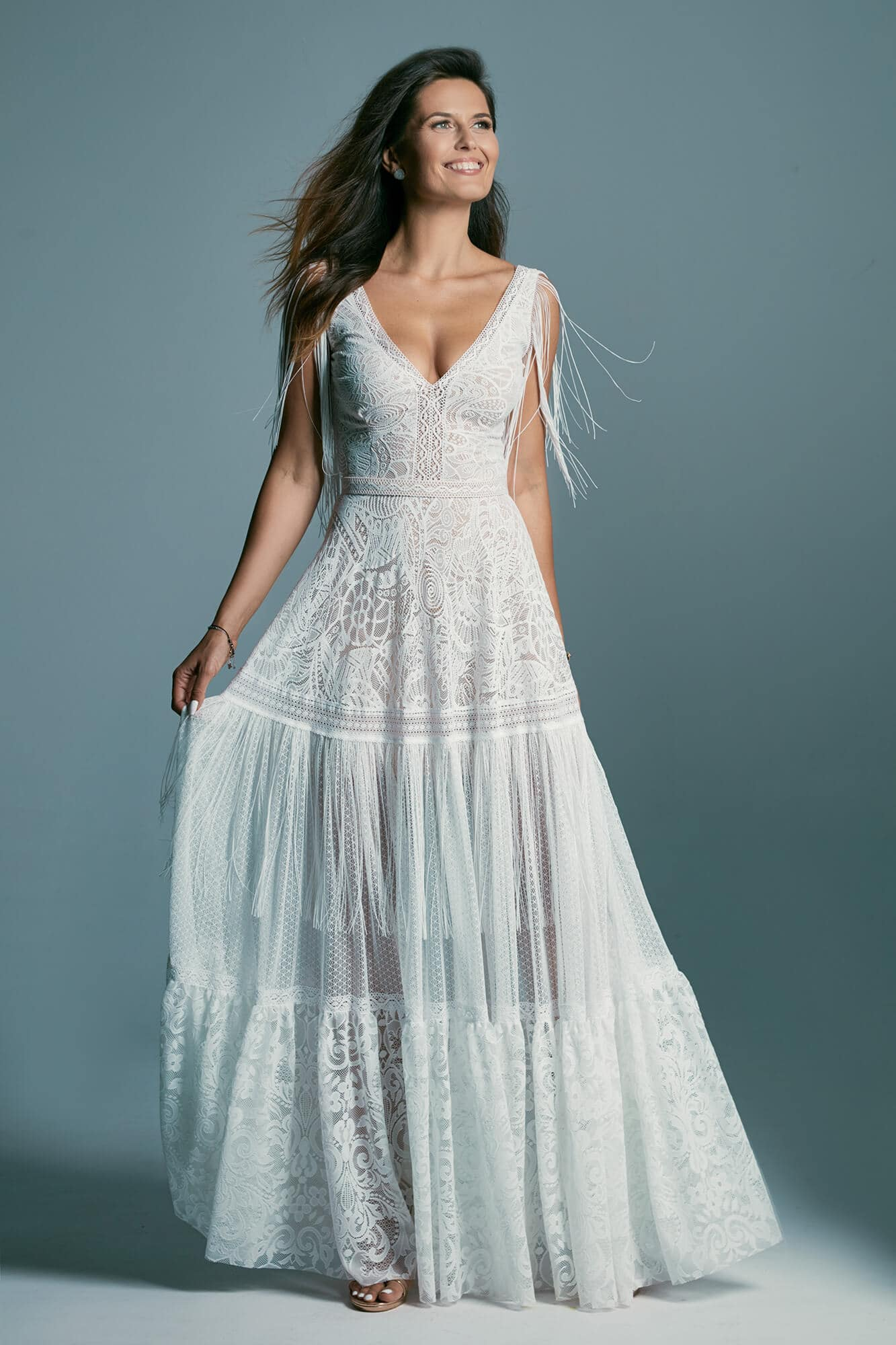 A richly decorated lace wedding dress, finished with fringes Santorini 5