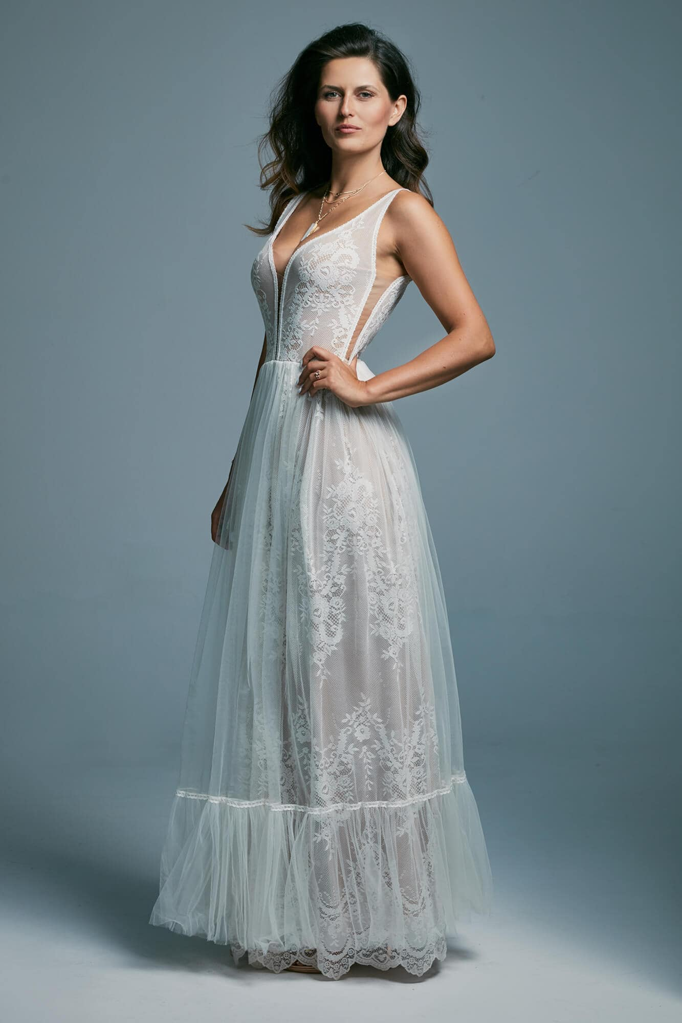 A light, airy wedding dress with a deep cut at the back Porto 15