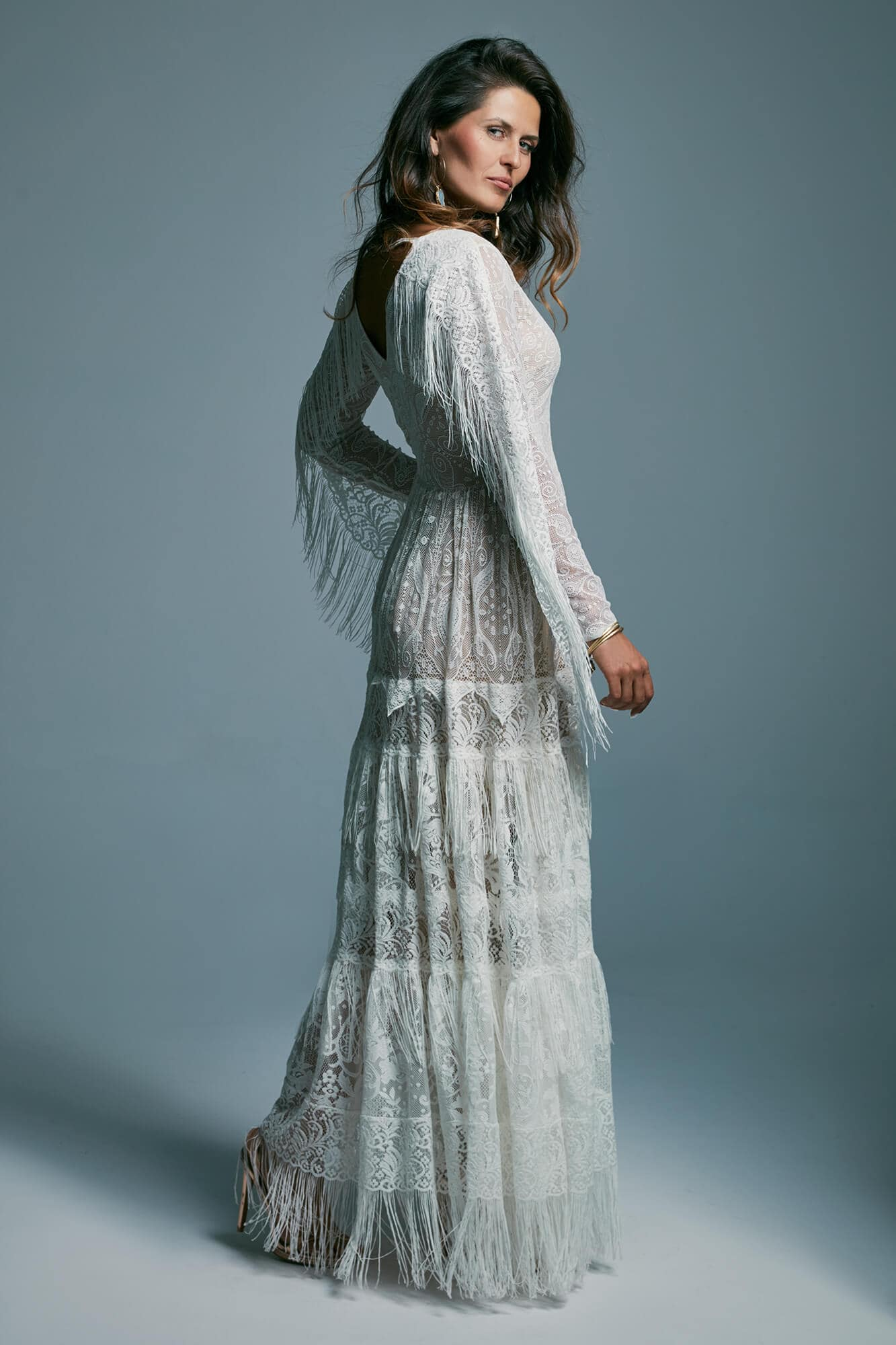 A wedding dress with a long, decorated sleeves and a fringed skirt Porto 7