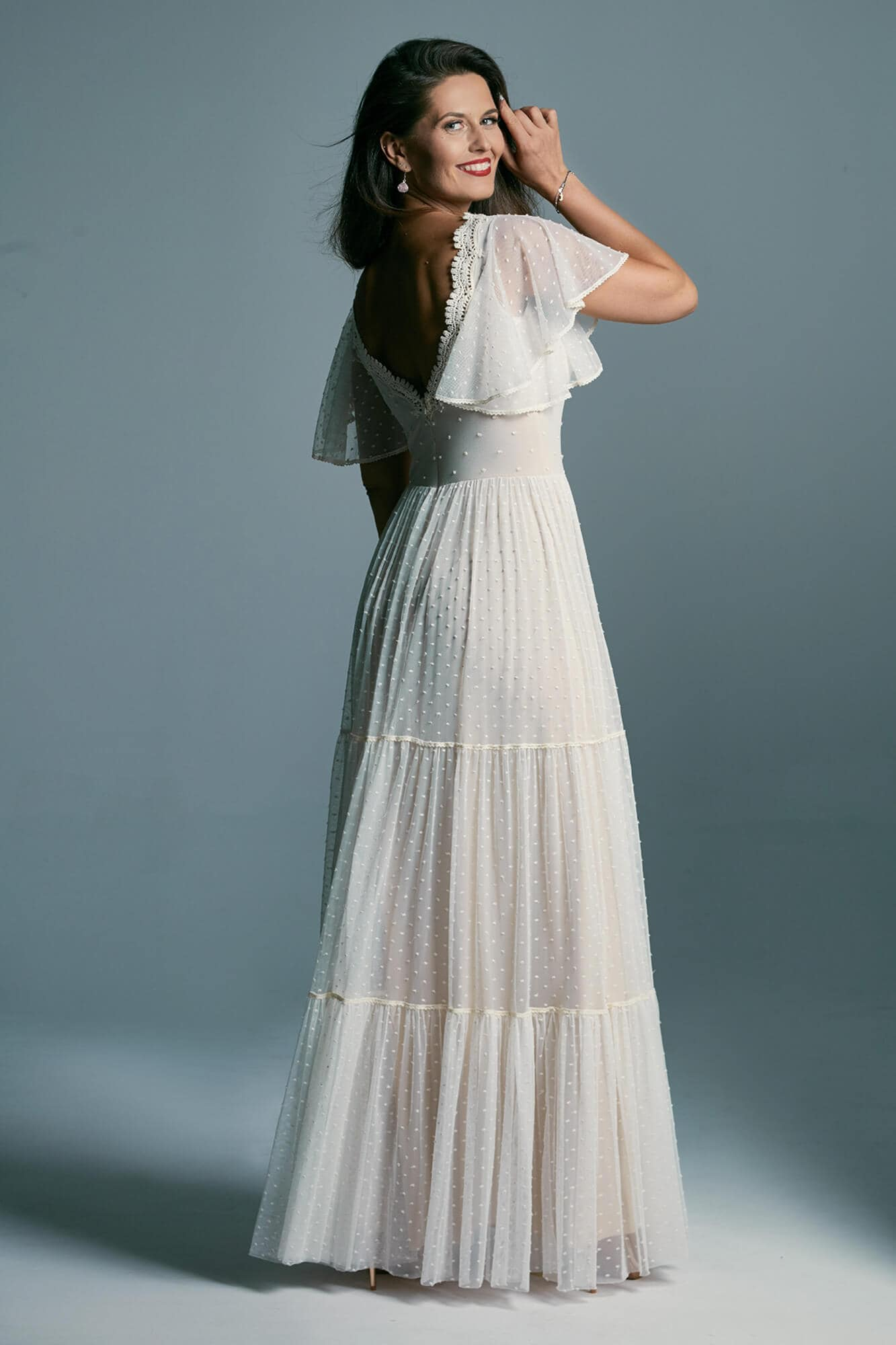 A romantic, beautifully finished wedding dress with butterfly sleeves Barcelona 16