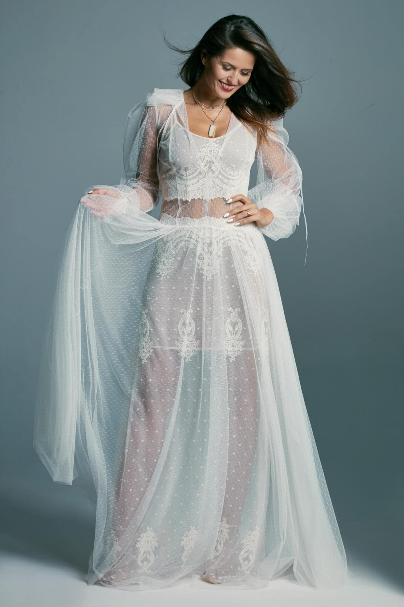 A beautiful wedding dress in a retro style covered with a delicate tulle Barcelona 20