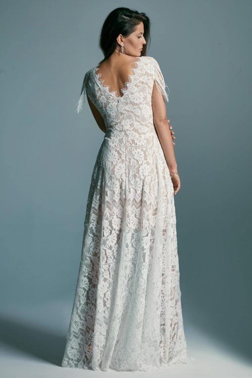 Impressive wedding dress extending the silhouette with a high neckline Porto 53