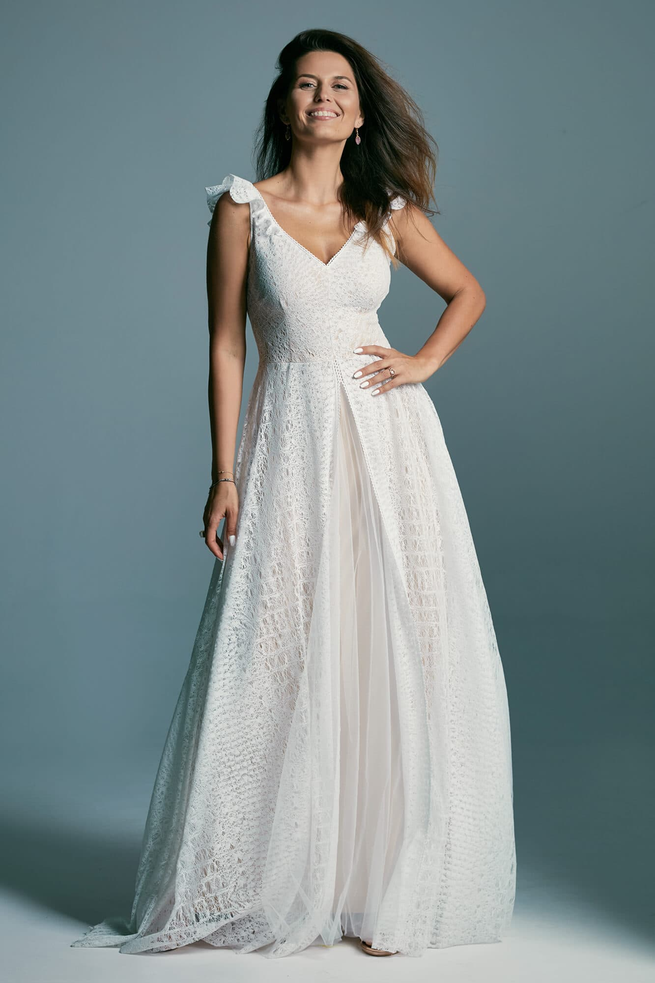 An airy wedding dress made of beautiful lace with an irregular pattern Santorini 4